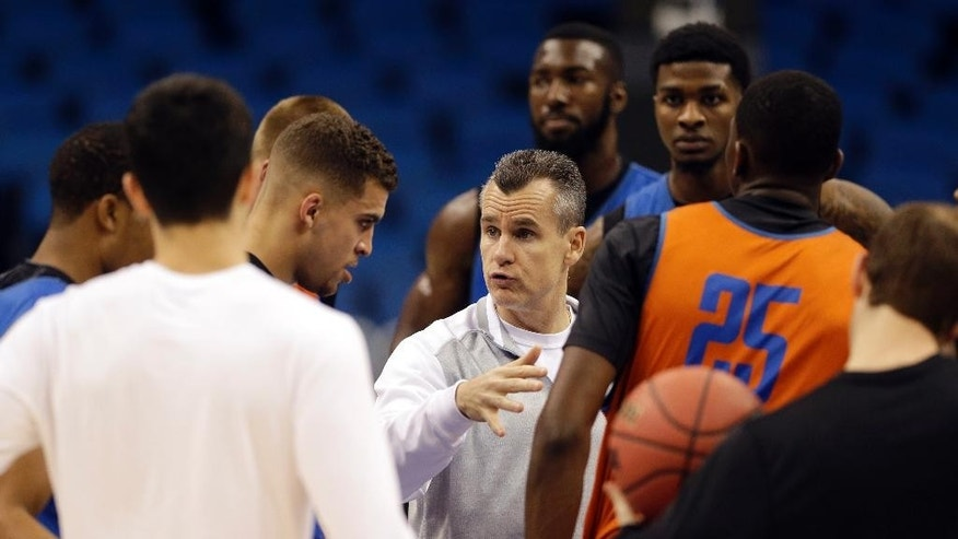 Florida head coach Billy Donovan, center, talks with his players during practice for the NCAA college basketball tournament in Orlando, Fla., Wednesday, March 19, 2014. Florida plays against Albany in a second round game on Thursday. (AP Photo/John Raoux)
