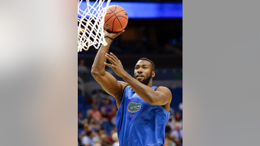 Florida's Patric Young takes a shot during practice for the NCAA college basketball tournament in Orlando, Fla., Wednesday, March 19, 2014. Florida plays against Albany in a second round game on Thursday. (AP Photo/John Raoux)