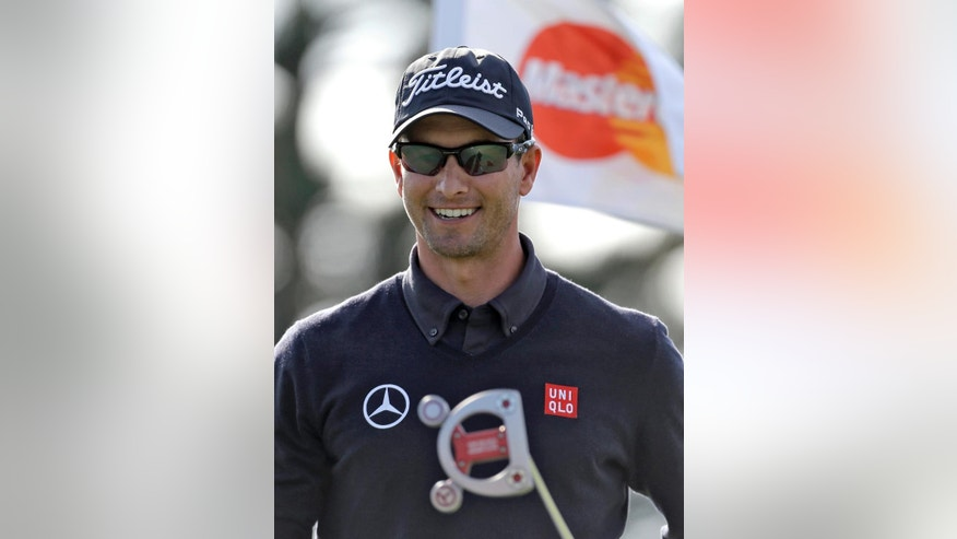Adam Scott, of Australia, smiles after making a birdie putt on the 15th hole during the first round of the Arnold Palmer Invitational golf tournament at Bay Hill Thursday, March 20, 2014, in Orlando, Fla. (AP Photo/Chris O'Meara)