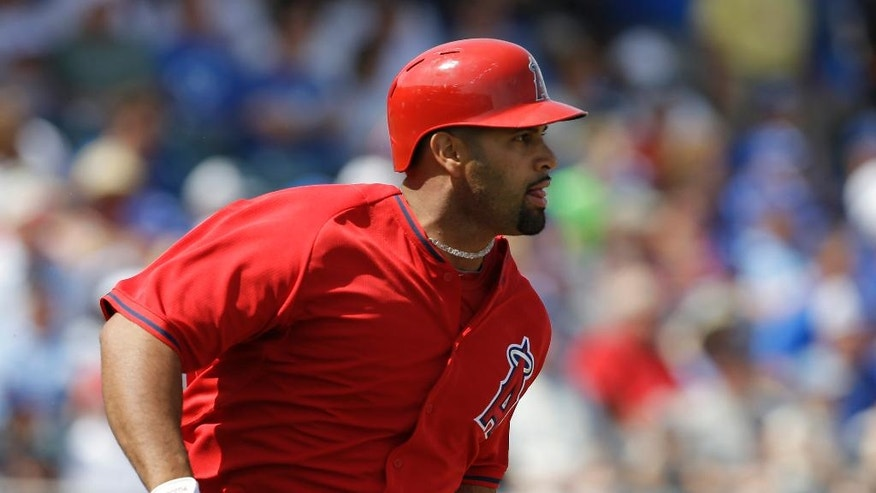 Los Angeles Angels' Albert Pujols runs after hitting a solo home run during the first inning of a spring exhibition baseball game against the Kansas City Royals on Thursday, March 20, 2014, in Surprise, Ariz. (AP Photo/Darron Cummings)