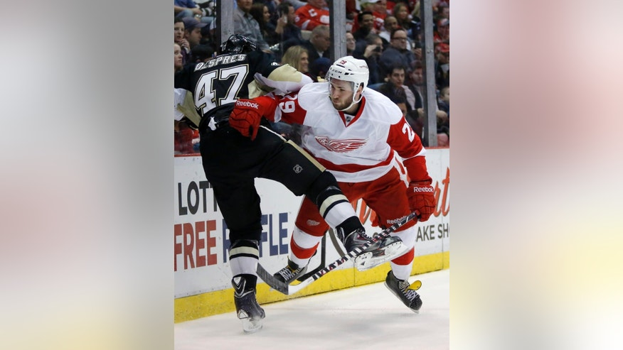 Pittsburgh Penguins' Simon Despres (47) is pushed against the boards by Detroit Red Wings' Landon Ferraro (29) during the second period of an NHL hockey game Thursday, March 20, 2014, in Detroit. (AP Photo/Duane Burleson)