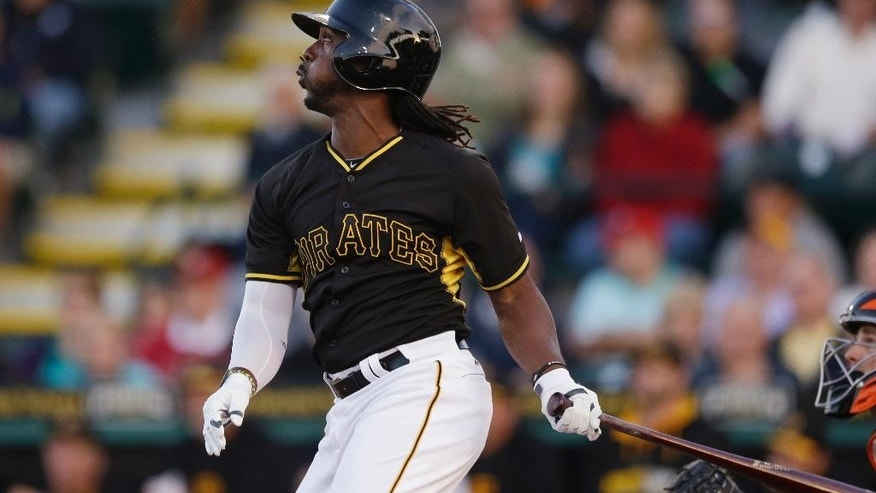 Pittsburgh Pirates' Andrew McCutchen watches his solo home run during the first inning of a spring exhibition baseball game against the Baltimore Orioles in Bradenton, Fla., Thursday, March 20, 2014. (AP Photo/Carlos Osorio)