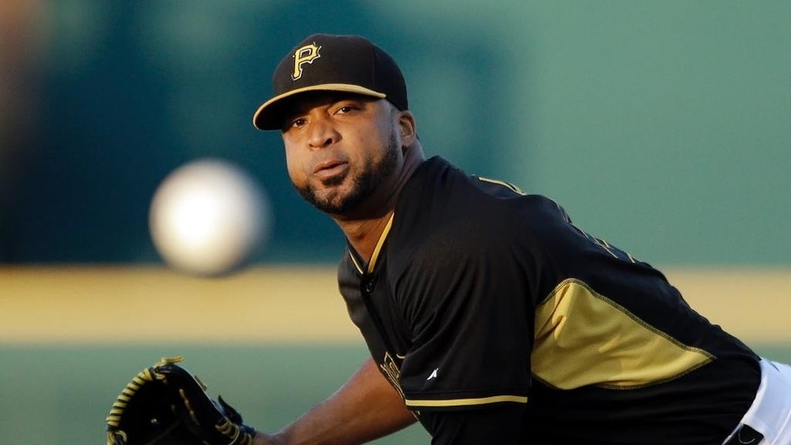 Pittsburgh Pirates starting pitcher Francisco Liriano throws during the first inning of a spring exhibition baseball game against the Baltimore Orioles in Bradenton, Fla., Thursday, March 20, 2014. (AP Photo/Carlos Osorio)