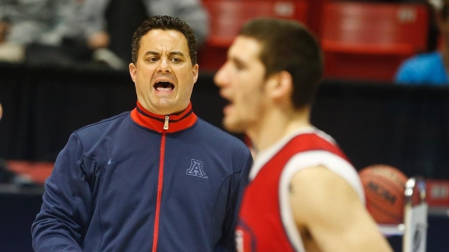 Arizona coach Sean Miller, left, shouts instructions during practice for an NCAA college basketball tournament game on Thursday, March 20, 2014, in San Diego. Arizona faces Weber State in a second-round game on Friday. (AP Photo/Lenny Ignelzi)