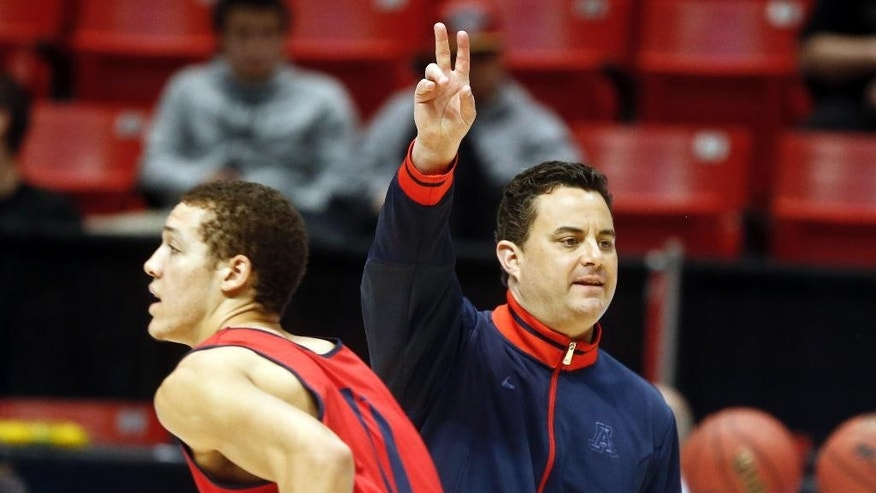 Arizona coach Sean Miller gives a signal during practice at the NCAA college basketball tournament Thursday, March 20, 2014, in San Diego. Arizona faces Weber State in a second-round game on Friday. (AP Photo/Lenny Ignelzi)