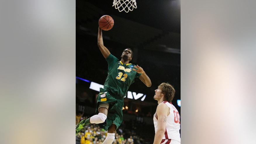 North Dakota State's TrayVonn Wright (32) goes up for a dunk against Oklahoma's Ryan Spangler (00) during the first half of a second-round game of the NCAA men's college basketball tournament in Spokane, Wash., Thursday, March 20, 2014. (AP Photo/Young Kwak)