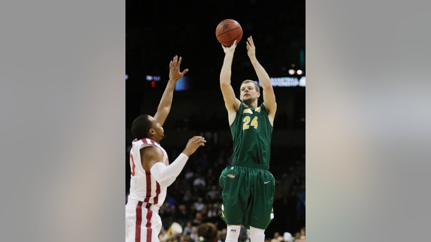 North Dakota State's Taylor Braun (24) shoots against Oklahoma's Jordan Woodard during the first half of a second-round game of the NCAA men's college basketball tournament in Spokane, Wash., Thursday, March 20, 2014. (AP Photo/Young Kwak)
