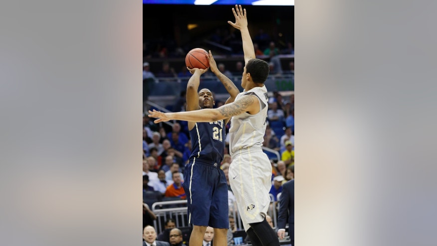 Colorado forward Dustin Thomas (13) defends Pittsburgh forward Lamar Patterson (21) during the second half in a second-round game in the NCAA college basketball tournament Thursday, March 20, 2014, in Orlando, Fla. (AP Photo/John Raoux)