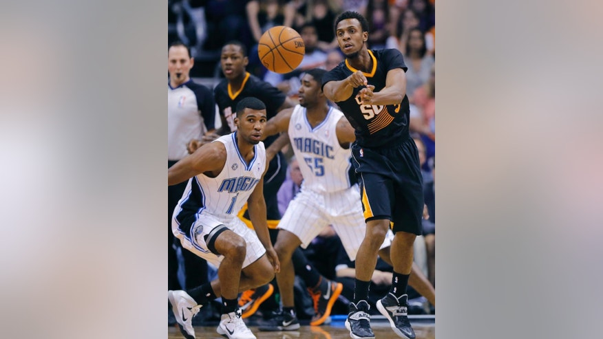 Phoenix Suns guard Ish Smith, right, passes as Orlando Magic guard Doron Lamb (1) defends during the first half of an NBA basketball game, Wednesday, March 19, 2014, in Phoenix. (AP Photo/Matt York)