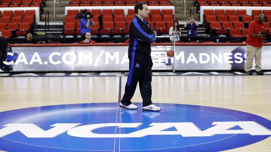 Duke head coach Mike Krzyzewski watches his team during practice at the NCAA college basketball tournament in Raleigh, N.C., Thursday, March 20, 2014. Duke plays Mercer in a second-round game on Friday. (AP Photo/Gerry Broome)