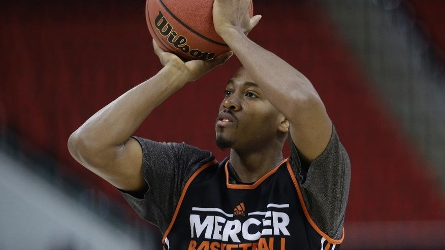 Mercer's Langston Hall shoots during practice at the NCAA college basketball tournament in Raleigh, N.C., Thursday, March 20, 2014. Mercer plays Duke in a second-round game on Friday. (AP Photo/Gerry Broome)