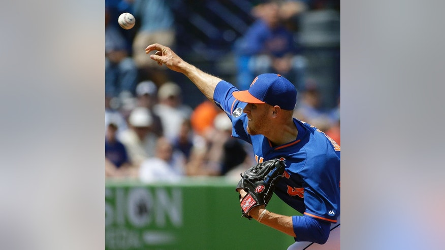New York Mets starting pitcher Zack Wheeler throws in the second inning of an exhibition spring training baseball game against the New York Mets, Thursday, March 20, 2014, in Port St. Lucie, Fla. (AP Photo/David Goldman)