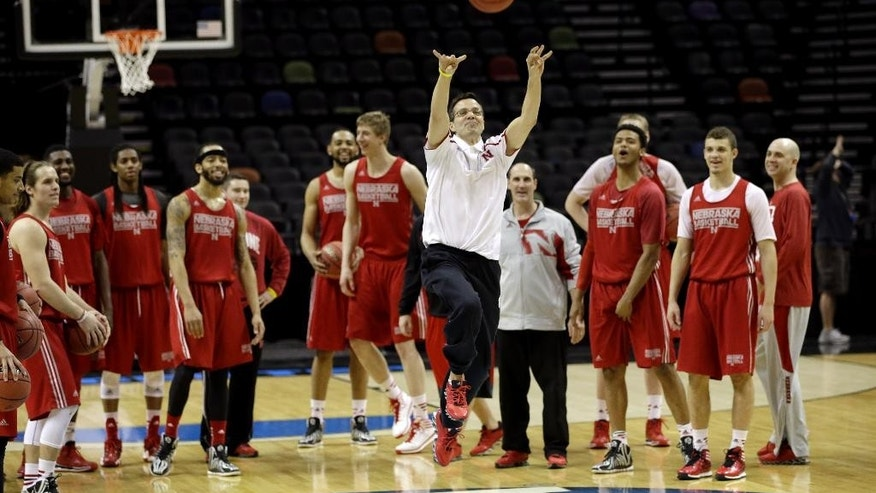 Nebraska coach Tim Miles shoots from half court as his team watches during practice for the NCAA college basketball tournament in San Antonio, Thursday, March 20, 2014. Nebraska plays against Baylor in a second-round game on Friday. (AP Photo/David J. Phillip)