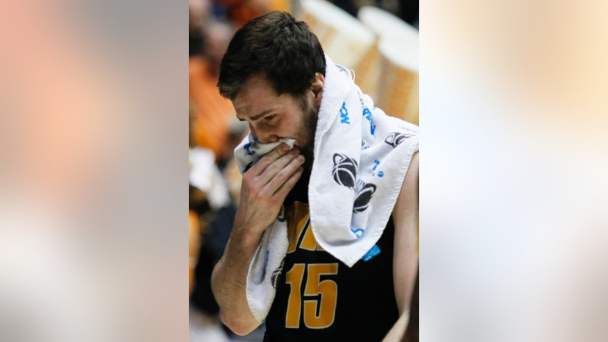 Iowa forward Zach McCabe walks off the court after they lost to Tennessee 78-65 in overtime of a first-round game of the NCAA college basketball tournament, Wednesday, March 19, 2014, in Dayton, Ohio. (AP Photo/Skip Peterson)