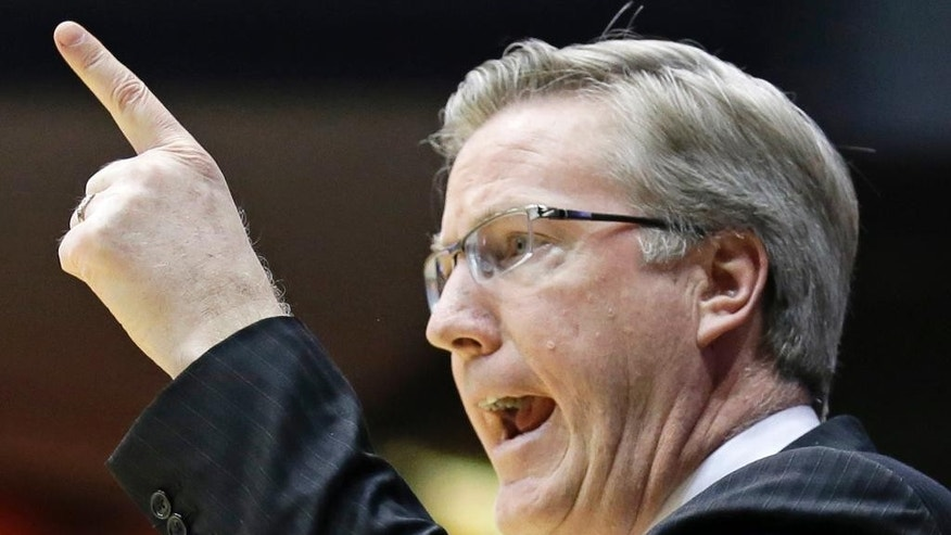 Iowa head coach Fran McCaffery calls a play in the first half of a first-round game against Tennessee at the NCAA college basketball tournament on Wednesday, March 19, 2014, in Dayton, Ohio. (AP Photo/Al Behrman)