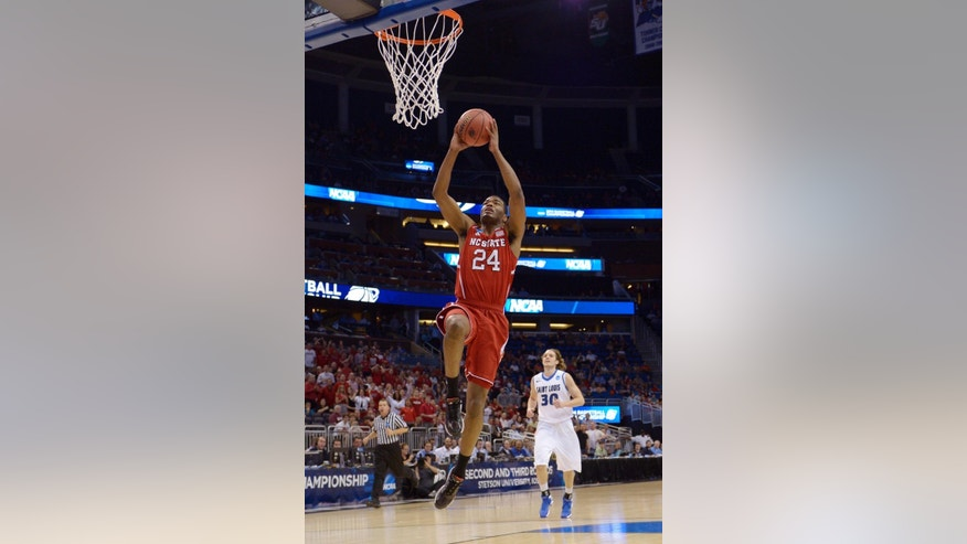 North Carolina State forward T.J. Warren (24) gets to the basket on a fast break ahead of Saint Louis forward Jake Barnett (30) during the first half of a second-round game in the NCAA college basketball tournament Thursday, March 20, 2014, in Orlando, Fla. (AP Photo/Phelan Ebenhack)