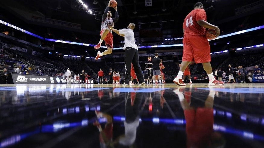 Louisiana-Lafayette's Shawn Long, left, drives to the basket during a practice for the NCAA college basketball tournament, Thursday, March 20, 2014, in San Antonio. Louisiana-Lafayette will face Creighton on Friday. (AP Photo/Eric Gay)