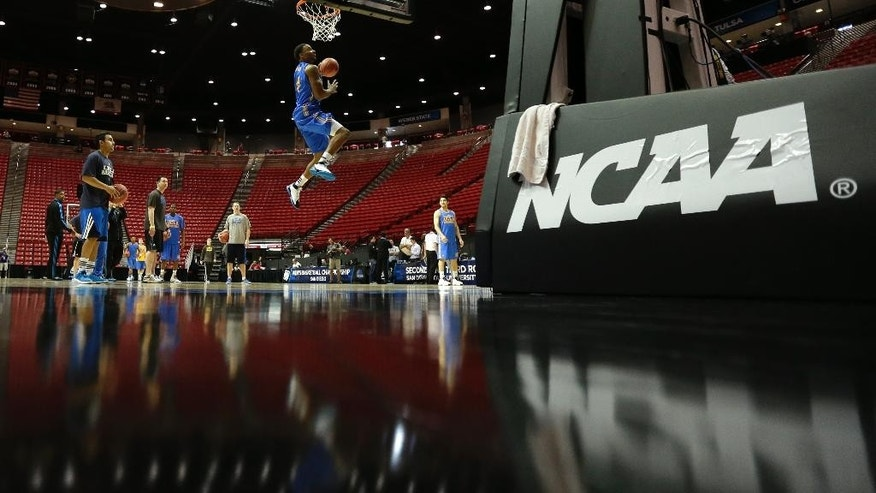 UCLA guard Norman Powell, center, shoots during practice at the NCAA college basketball tournament Thursday, March 20, 2014, in San Diego. UCLA faces Tulsa in a second-round game on Friday. (AP Photo/Gregory Bull)