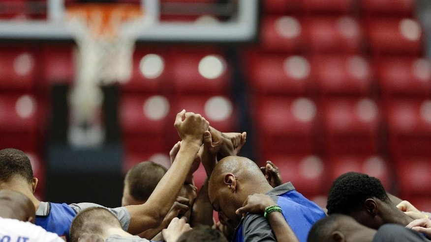 Tulsa head coach Danny Manning, center right, gathers his team during practice at the NCAA college basketball tournament Thursday, March 20, 2014, in San Diego. Tulsa faces UCLA in a second-round game on Friday. (AP Photo/Gregory Bull)