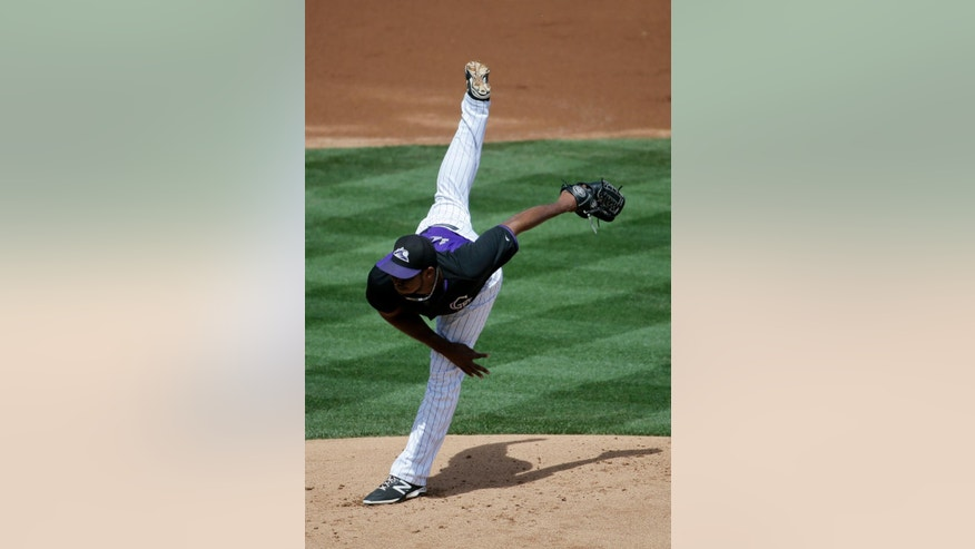 Colorado Rockies starting pitcher Juan Nicasio follows through with a pitch to the Milwaukee Brewers during the first inning of a spring exhibition baseball game in Scottsdale, Ariz., Thursday, March 20, 2014. (AP Photo/Chris Carlson)