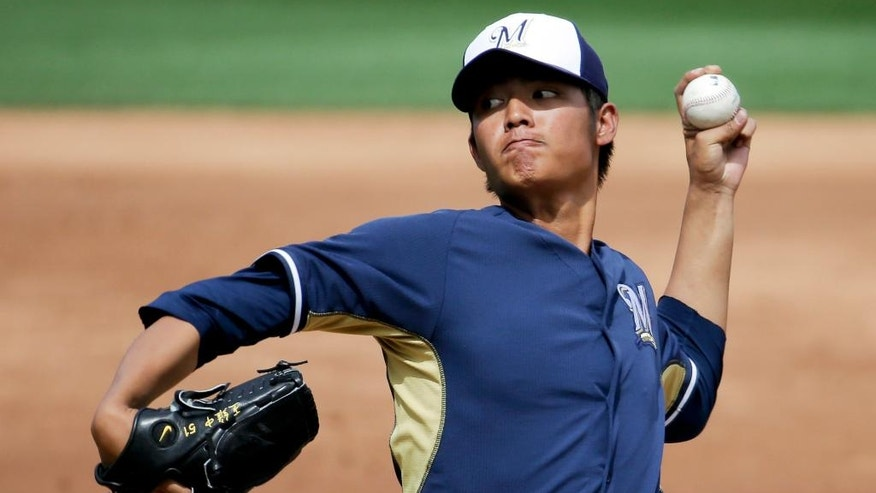 Milwaukee Brewers starting pitcher Wei-Chung Wang throws to the Colorado Rockies during the second inning of a spring exhibition baseball game in Scottsdale, Ariz., Thursday, March 20, 2014. (AP Photo/Chris Carlson)