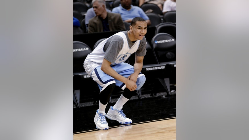 North Carolina's Marcus Paige reacts after missing a shot during practice for the NCAA men's college basketball tournament in San Antonio, Thursday, March 20, 2014. North Carolina plays Providence in a second-round game Friday. (AP Photo/David J. Phillip)