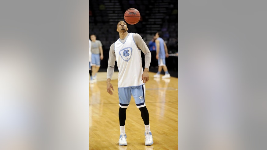 North Carolina's J.P. Tokoto bounces the ball off his shoulder during practice for the NCAA college basketball tournament in San Antonio, Thursday, March 20, 2014. North Carolina plays Providence in a second-round game on Friday. (AP Photo/David J. Phillip)