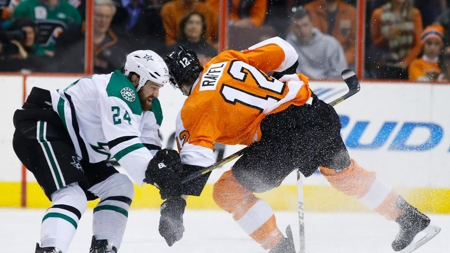 Dallas Stars' Jordie Benn, left, collides with Philadelphia Flyers' Michael Raffl, of Austria, during the first period of an NHL hockey game, Thursday, March 20, 2014, in Philadelphia. Benn was penalized for hooking on the play. (AP Photo/Matt Slocum)