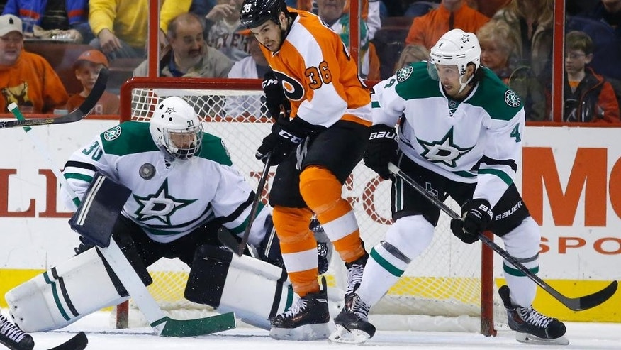 Philadelphia Flyers' Zac Rinaldo (36) tries get a shot past Dallas Stars goalie Tim Thomas (30) and Brenden Dillon (4) during the first period of an NHL hockey game, Thursday, March 20, 2014, in Philadelphia. (AP Photo/Matt Slocum)