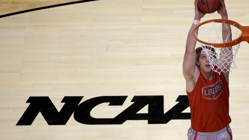 New Mexico's Cameron Bairstow dunks the ball during practice for the NCAA college basketball tournament Thursday, March 20, 2014, in St. Louis. New Mexico is scheduled to play against Stanford in a second-round game on Friday. (AP Photo/Charlie Riedel)