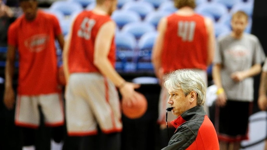 New Mexico head coach Craig Neal watches during practice for the NCAA college basketball tournament Thursday, March 20, 2014, in St. Louis. New Mexico is scheduled to play against Stanford in a second-round game on Friday. (AP Photo/Charlie Riedel)