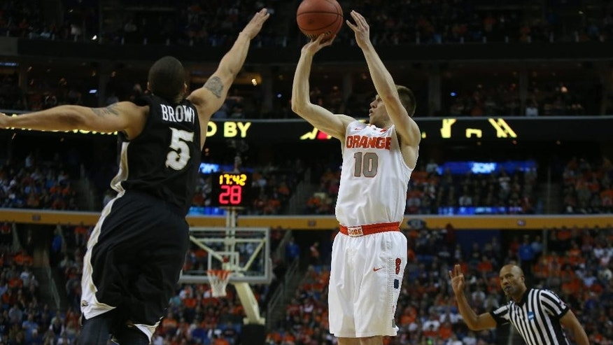 Syracuse's Trevor Cooney (10) puts up a 3-pointer over Western Michigan's David Brown (5) in a second-round game of the NCAA college basketball tournament in Buffalo, N.Y., Thursday, March 20, 2014.  (AP Photo/The Buffalo News, Robert Kirkham) TV OUT; MAGS OUT; MANDATORY CREDIT; BATAVIA DAILY NEWS OUT; DUNKIRK OBSERVER OUT; JAMESTOWN POST-JOURNAL OUT; LOCKPORT UNION-SUN JOURNAL OUT; NIAGARA GAZETTE OUT; OLEAN TIMES-HERALD OUT; SALAMANCA PRESS OUT; TONAWANDA NEWS OUT