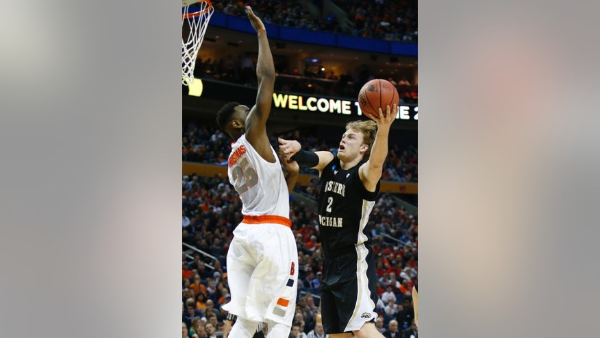 Western Michigan's Connar Tava (2) shoots against Syracuse's Rakeem Christmas (25) during the first half of a second-round game in the NCAA college basketball tournament in Buffalo, N.Y., Thursday, March 20, 2014. (AP Photo/Nick LoVerde)