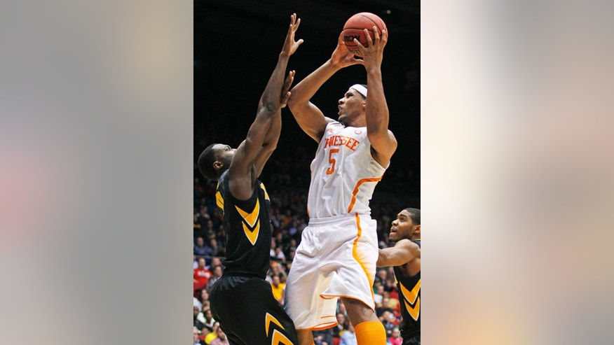 Tennessee forward Jarnell Stokes (5) shoots against Iowa center Gabriel Olaseni in the second half of a first-round game of the NCAA college basketball tournament on Wednesday, March 19, 2014, in Dayton, Ohio. (AP Photo/Skip Peterson)