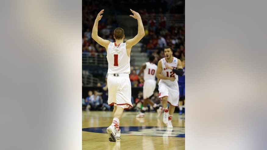 Wisconsin guard Ben Brust (1) celebrates after scoring a three pointer during the second half of a second-round game against the American in the NCAA college basketball tournament Thursday, March 20, 2014, in Milwaukee. (AP Photo/Morry Gash)