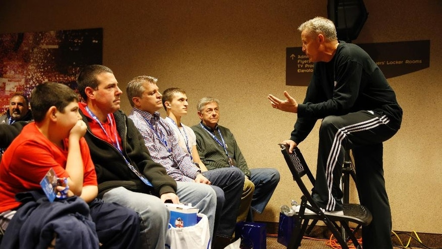 ADVANCE FOR WEEKEND EDITIONS, MARCH 22-23 - In this photo taken on March 19, 2014, Philadelphia 76ers head coach Brett Brown talks with season ticket holders before an NBA basketball game against the Chicago Bulls in Philadelphia. On the court, the 76ers are a mess. Their 21-game losing streak is the longest in franchise history and they are shaping up as one of the worst teams in NBA history. Behind the scenes, the Sixers are working at a championship pace. (AP Photo/Matt Slocum)