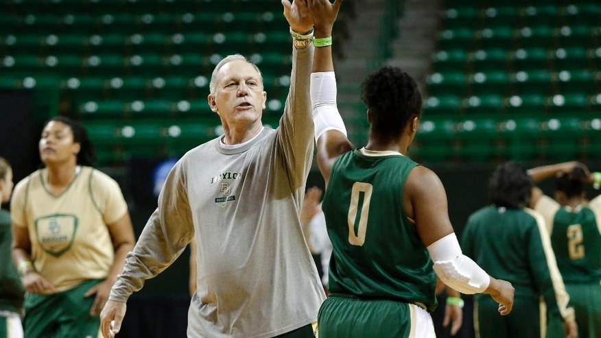 Baylor associate head coach Bill Brock gets a high-five from Odyssey Sims (0) during practice at the NCAA women's college basketball tournament, Friday, March 21, 2014, in Waco, Texas. Baylor plays Western Kentucky in a first-round game on Saturday. (AP Photo/Tony Gutierrez)