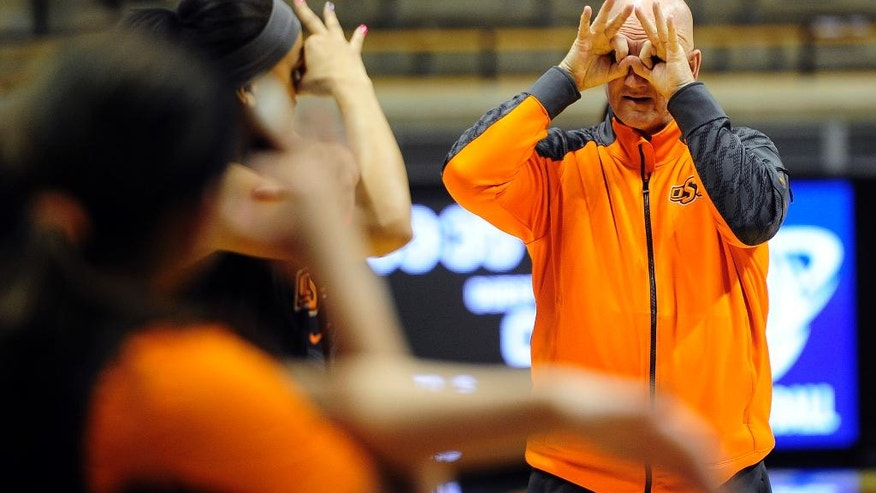 CORRECTS TEAM TO OKLAHOMA STATE, NOT FLORIDA GULF COAST - Jack Easley, director of player development at Oklahoma State, jokes on court with Brianne Coffman during practice at the women's NCAA college basketball tournament in West Lafayette, Ind., Friday, March 21, 2014.  Florida Gulf Coast plays Oklahoma State in a first-round game on Saturday. (AP Photo/Naples Daily News, Corey Perrine) FORT MYERS OUT, MAGS OUT, TV OUT