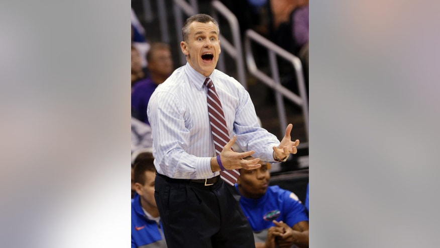 Florida coach Billy Donavan gestures to his team during the second half in a second-round game against Albany in the NCAA men's college basketball tournament Thursday, March 20, 2014, in Orlando, Fla. (AP Photo/John Raoux)