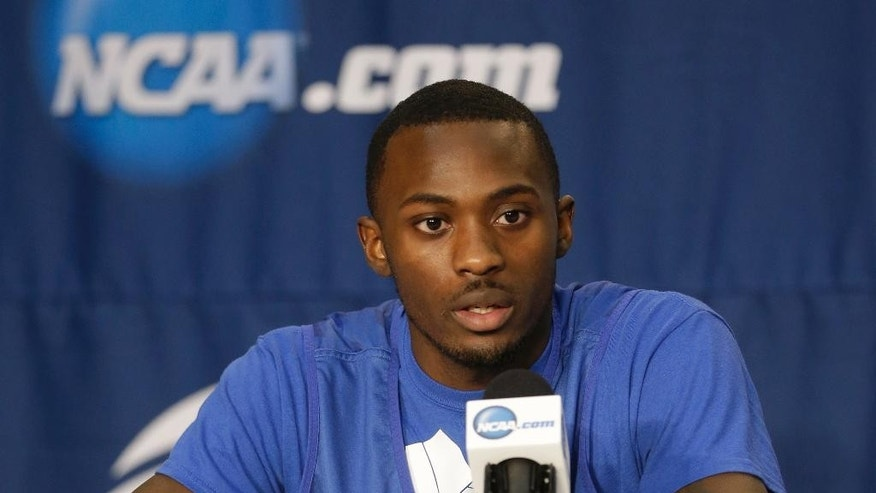 Saint Louis guard Mike McCall Jr. speaks at a news conference at the NCAA mens college basketball tournament Friday, March 21, 2014, in Orlando, Fla. Saint Louis will play Louisville in the third-round game on Saturday. (AP Photo/John Raoux)