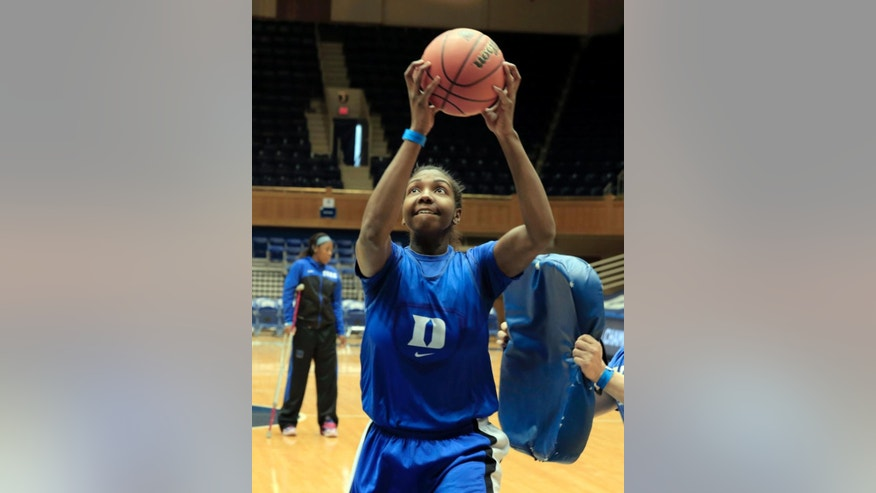 Duke's Elizabeth Williams shoots during practice for the NCAA women's college basketball tournament in Durham, N.C., Friday, March 21, 2014.  Duke faces Winthrop in the first round on Saturday. (AP Photo/Ted Richardson)