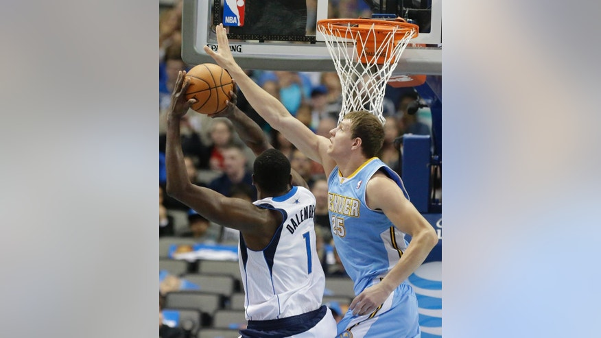 Denver Nuggets center Timofey Mozgov (25) of Russia blocks a shot against Dallas Mavericks center Samuel Dalembert (1) during the first half an NBA basketball game Friday, March 21, 2014, in Dallas. (AP Photo/LM Otero)
