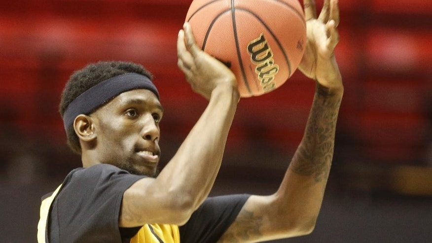 VCU guard Briante Weber shoots during practice for the NCAA basketball tournament game Thursday, March 20, 2014, in San Diego. VCU faces Stephen F. Austin in a second-round game on Friday. (AP Photo/Lenny Ignelzi