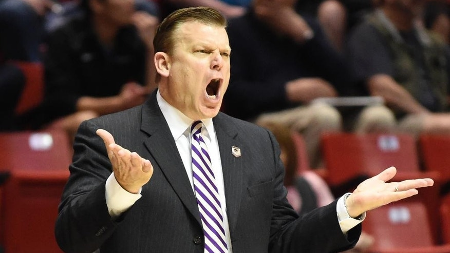 Stephen F. Austin head coach Brad Underwood gestures as the team plays Virginia Commonwealth during the first half of a second-round game in the NCAA college basketball tournament Friday, March 21, 2014, in San Diego. (AP Photo/Denis Poroy)