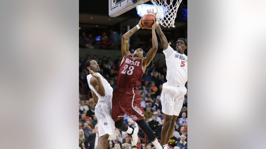 New Mexico State's Daniel Mullings (23) tries to shoot between San Diego State's Dwayne Polee II (5) and Xavier Thames in the first half of a second-round game of the NCAA men's college basketball tournament in Spokane, Wash., Thursday, March 20, 2014. (AP Photo/Elaine Thompson)
