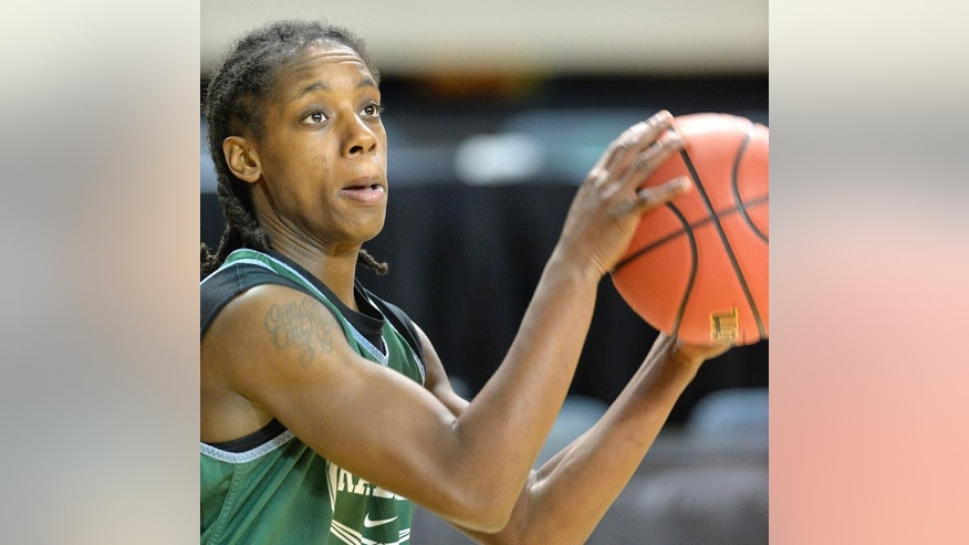 Wright State's Kim Demmings participates in shooting drills during practice for the NCAA women's college basketball tournament in Lexington, Ky., Friday, March 21, 2014. Wright State plays Kentucky in a first-round game Saturday.  (AP Photo/Timothy D. Easley)