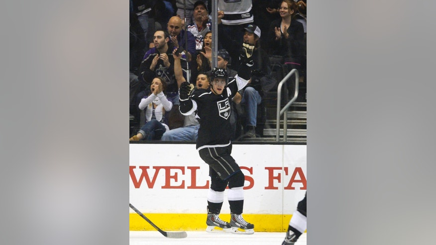 Los Angeles Kings center Anze Kopitar, of Slovenia, celebrates his goal during the first period of an NHL hockey game against the Washington Capitals, Thursday, March 20, 2014, in Los Angeles. (AP Photo/Mark J. Terrill)