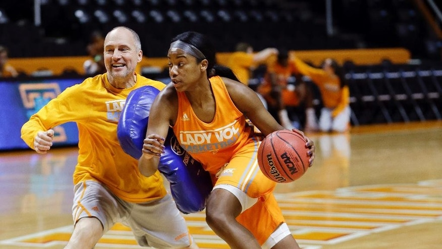 Tennessee guard Jordan Reynolds drives against assistant coach Dean Lockwood during practice for the NCAA women's college basketball tournament Friday, March 21, 2014, in Knoxville, Tenn. Tennessee will face Northwestern State in a first-round game on Saturday. (AP Photo/Mark Humphrey)