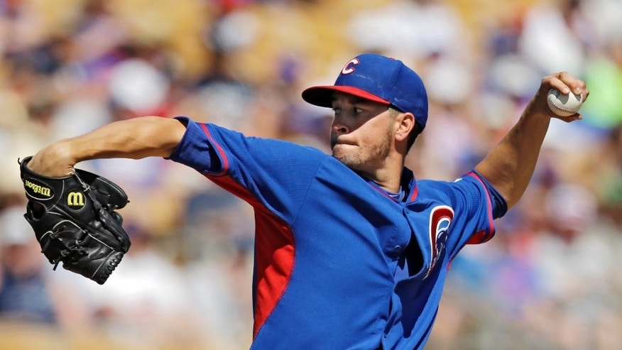 Chicago Cubs starting pitcher Chris Rusin delivers against the Chicago White Sox in the third inning of a spring exhibition baseball game Friday, March 21, 2014, in Glendale, Ariz. (AP Photo/Mark Duncan)