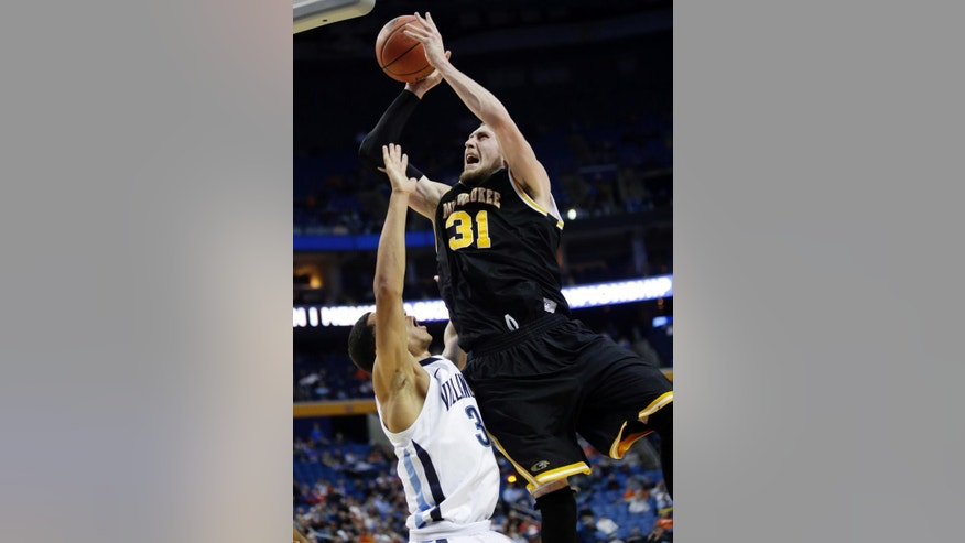 Milwaukee's Matt Tiby (31) shoots over Villanova's Josh Hart (3) during the second half of a second-round game in the NCAA college basketball tournament in Buffalo, N.Y., Thursday, March 20, 2014. (AP Photo/Nick LoVerde)